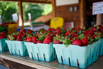 Photo of strawberries for sale.