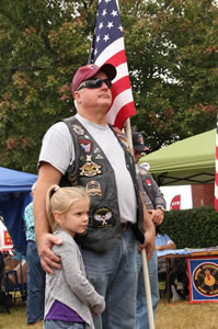 image of veteran with flag