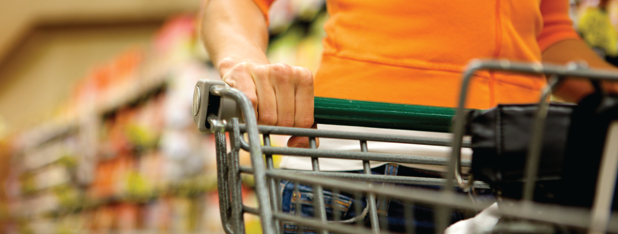 woman pushing grocery cart