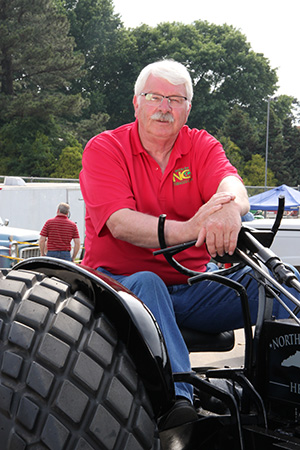 Troxler on a modified tractor celebrating Wounded Warrior Project